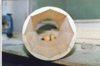 Woodworking a wooden column.