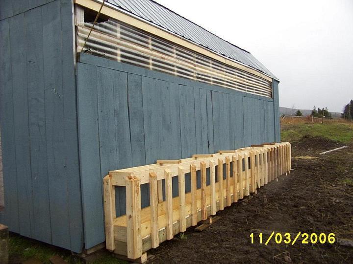 Sheep farm feed bins.