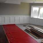 Woodworking wainscoting and walnut flooring.