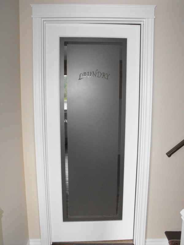 Frosted glass laundry room door.