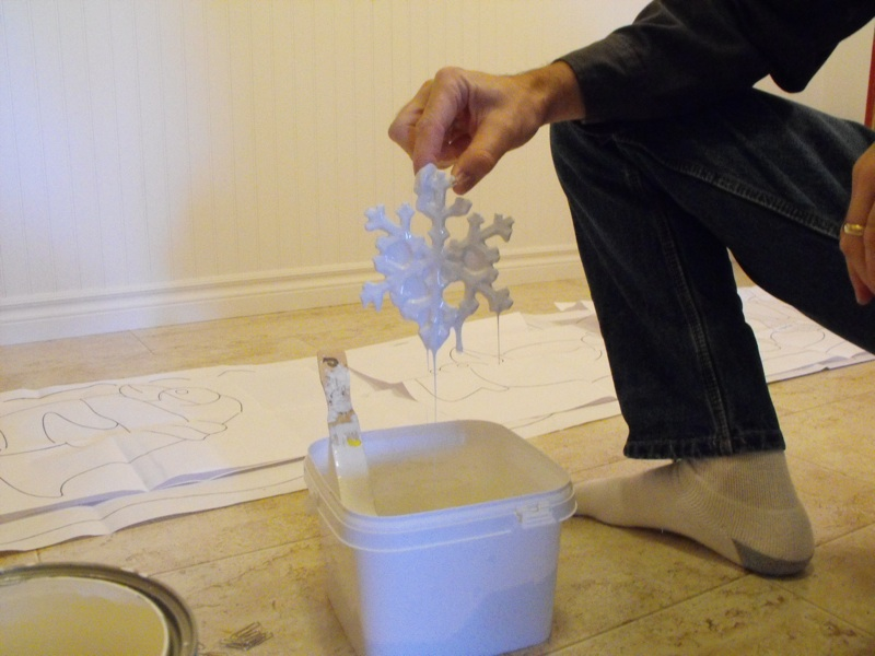 Dipping snowflakes in paint.