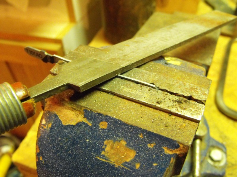 Back filing the jig saw blade.