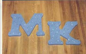 M and K scroll sawn letters