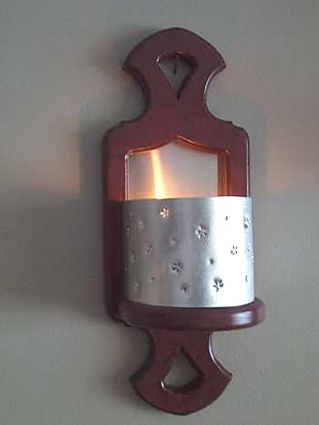 Candle lit wall sconce.