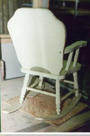 Back side of vintage child rocker.
