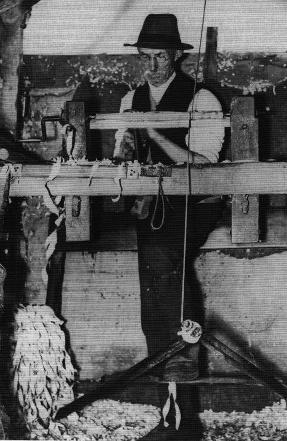 carpenter Bodger at work, making a chair leg on a foot powered lathe