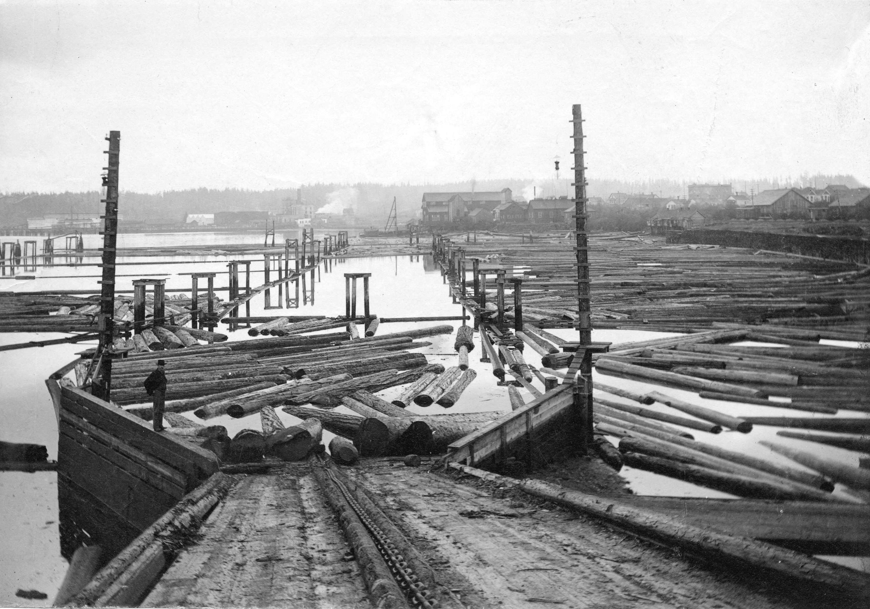 1899-Log booms at Hastings Sawmill.