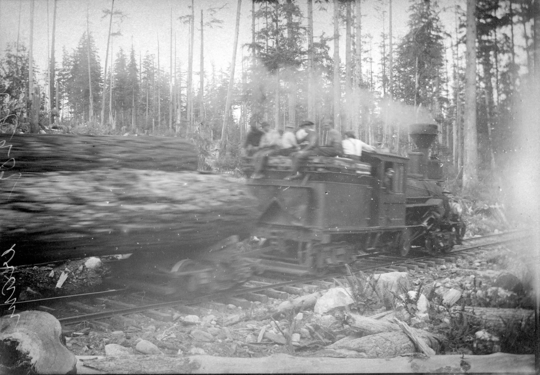 1890s Steam engine hauling logs.