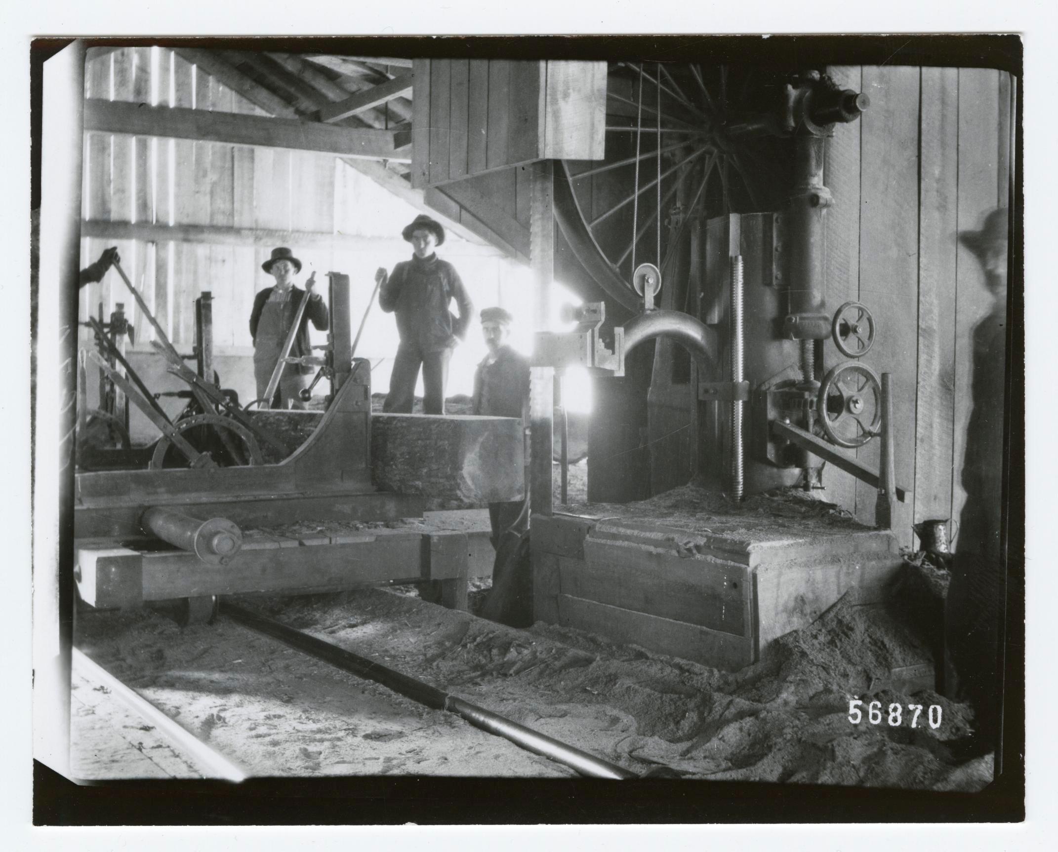1900 3 men posing for the camera sawmill interior.