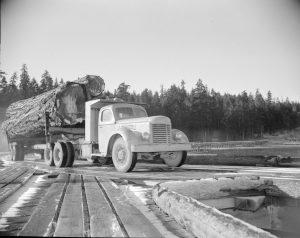 1940s-Logging truck on the H.R. MacMillan Co. wharf.