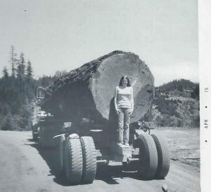 vintage logging photos, olf forestry photographs, women, big logs on truck, trucking