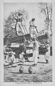 Early photo of Syrian carpenters using saw pit frames.