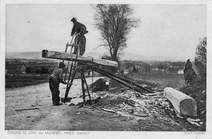 Frenchmen in Montet, France using a sawpit.