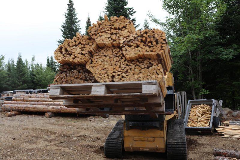 skidsteer, bundles of wood