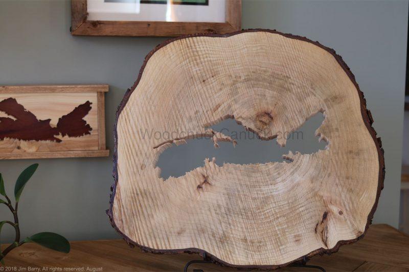 Nova Scotia map cut into a slice of maple wood.