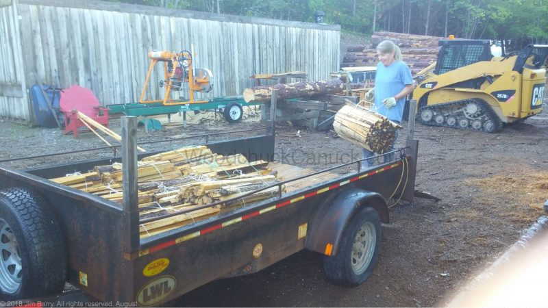 Loading the trailer with wood