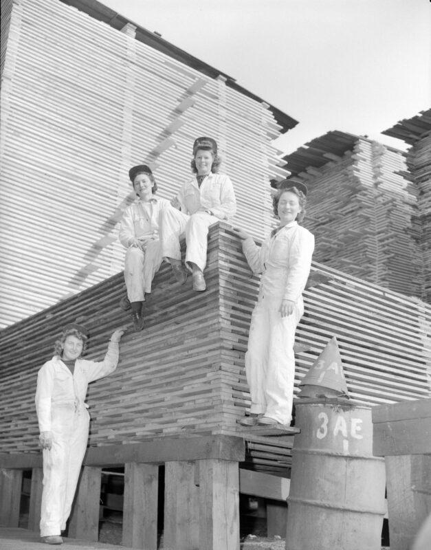 WTC, Women's Timber Corp., creative commons, lumber jill, machinery, stacked lumber, women