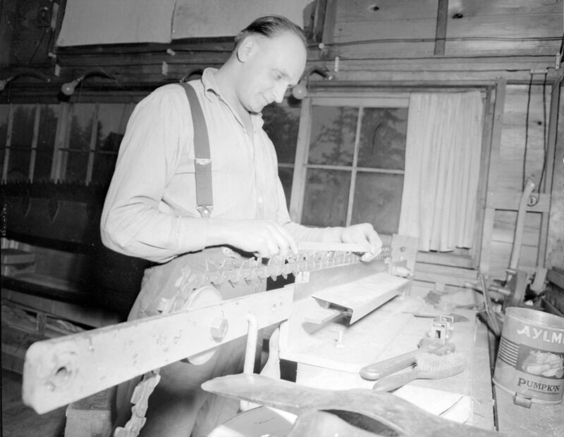 1945 Man adjusting saw blade at Pacific Mills, Queen Charlotte Islands