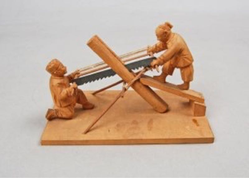 Vintage logging - Saw pits : A wood carving depicting Chinese sawyers.