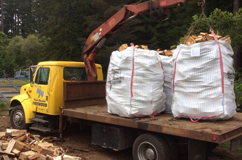 Firewood truck delivering bagged firewood.