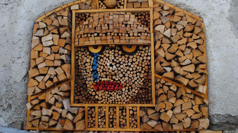 Artistic display in firewood piles.
