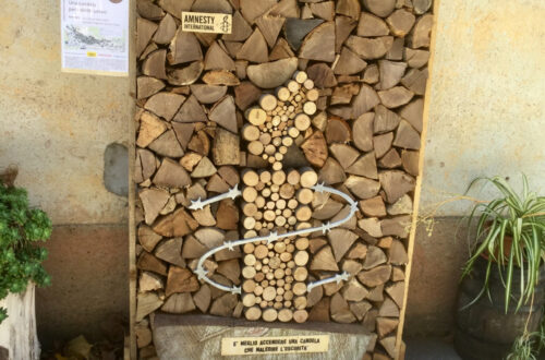 Amnesty International firewood art work.