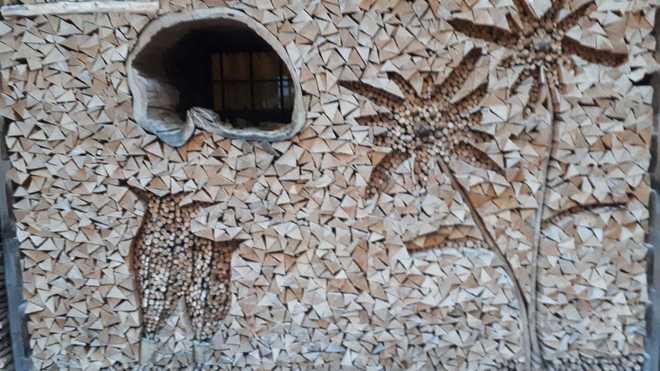 Creative art in firewood piles.