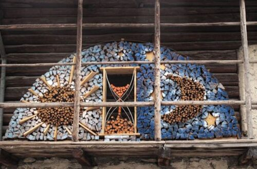 Time piece art work in firewood piles.