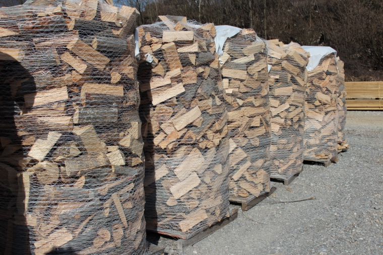 Plastic netting wrapped firewood.