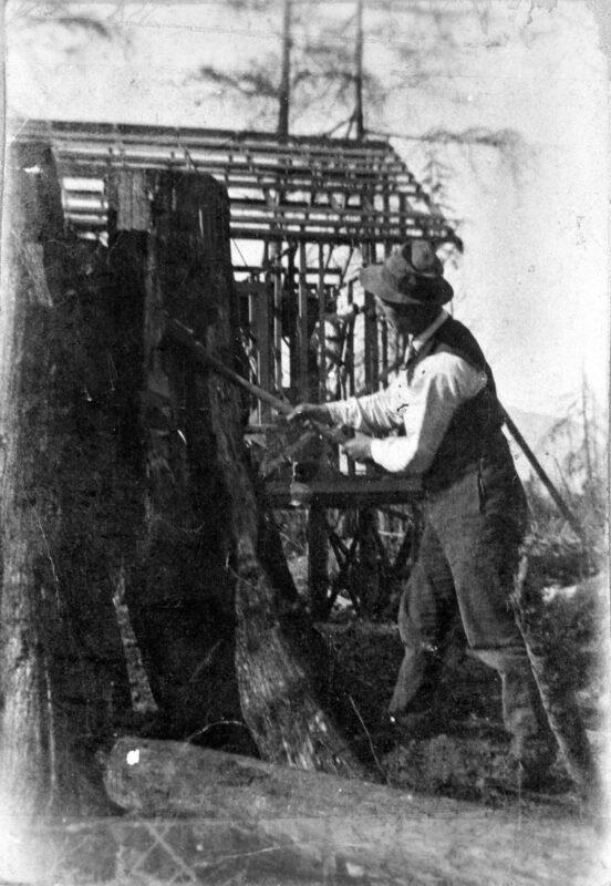 1912 Mr. Mount hewing tree stump