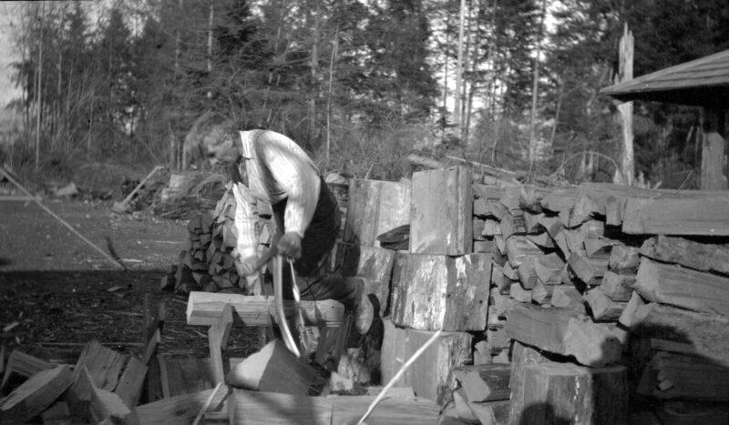 1911 Firewood being cut on sawhorse with a bucksaw