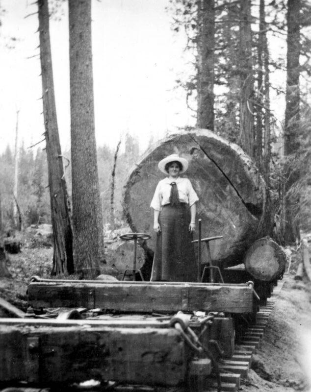 1909 Woman Standing on Diamond Rail Car with Large Log.