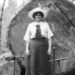 1909 Woman Standing on Diamond Rail Car with Large Log.