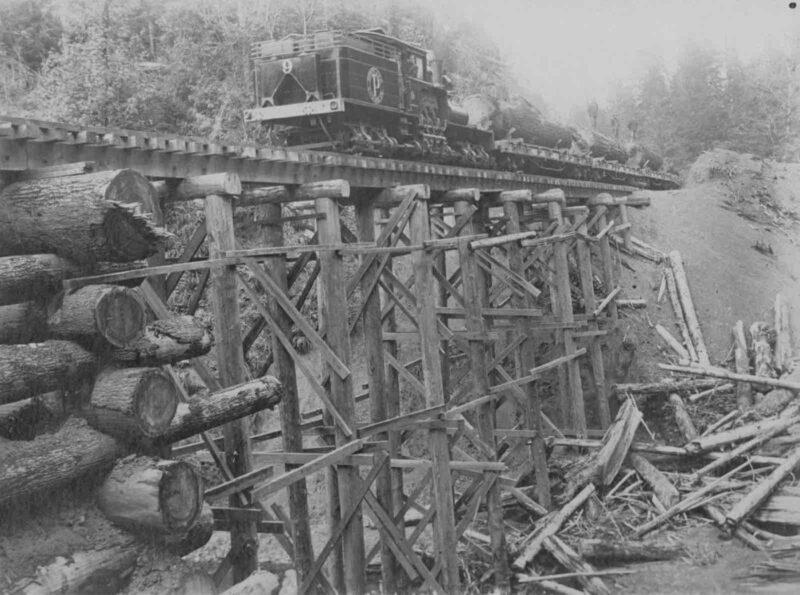 Portland Lumber Co., Locomotive no. 9. on wooden trestle.
