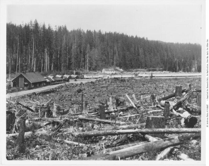 Logging camp of Elk River Timber Co. adjacent to clear cut land.