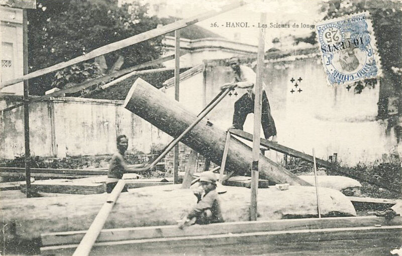 A post card featuring two sawyers with a saw pit frame in Hanoi.
