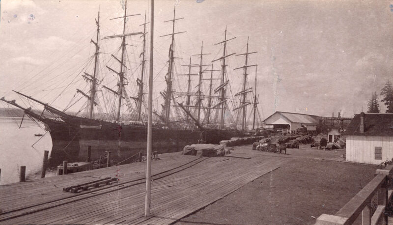 1888 Moodyville Milling Company loading dock with two ships at bay.