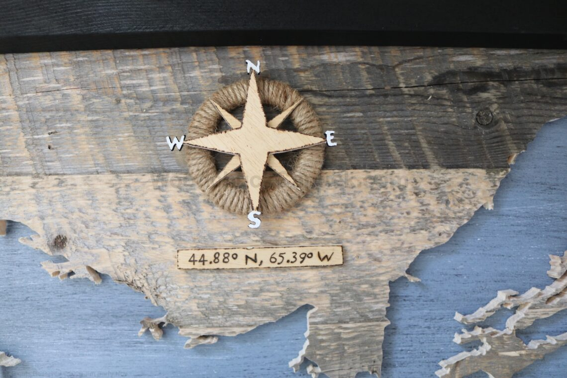 Wood map of NS with compass.
