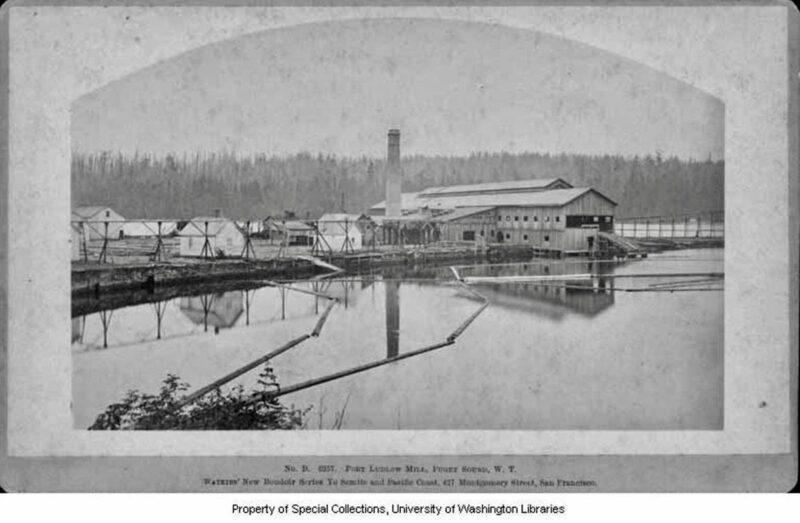 1882 Puget Mill Co. sawmill and log pond. Port Ludlow, WA.
