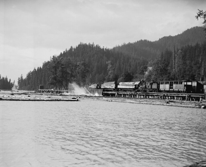 "1932 Green Point Logging Co. Ltd. ""Shay"" locomotive working at log dump."