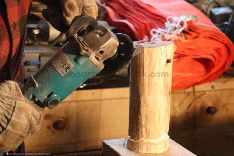 Shaping the carved tree.