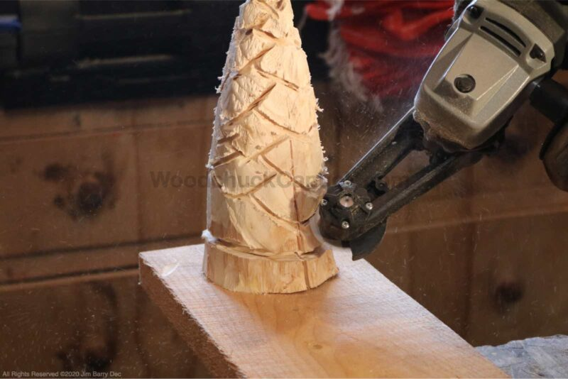 Contouring the carved tree.