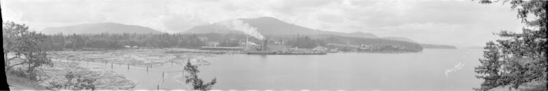 1925 Booming grounds, Victoria Lumber and Manufacturing Co. Ltd. and Chemainus in the background.
