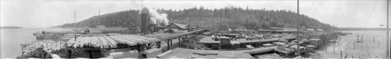 1935 A panoramic view of Straits Lumber Co. sawmill, Red Gap, B.C. showing docks and barges.