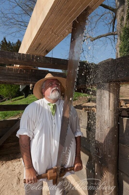 A carpenter pit sawing at Colonial Williamsburg.