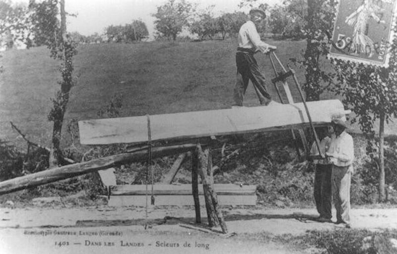 A post card show French carpenters using a saw pit.
