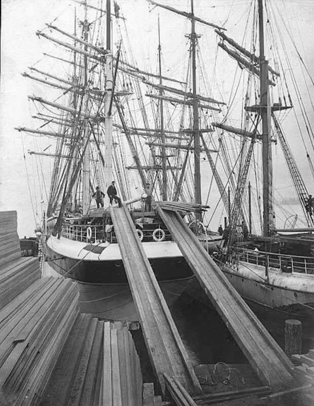 1893-1903 BENICIA in dock with crew members.