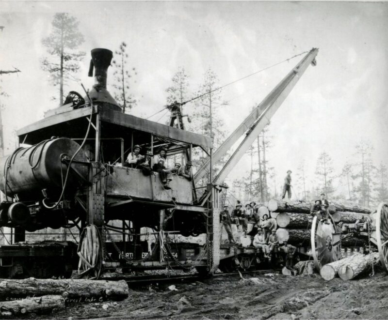 High wheel logging with a loader rail car.