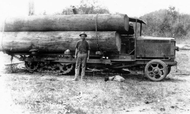 Big logs on tracked truck.