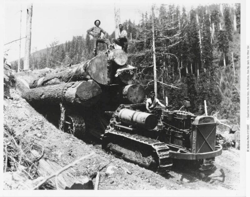 Big logs hauled by tractor.